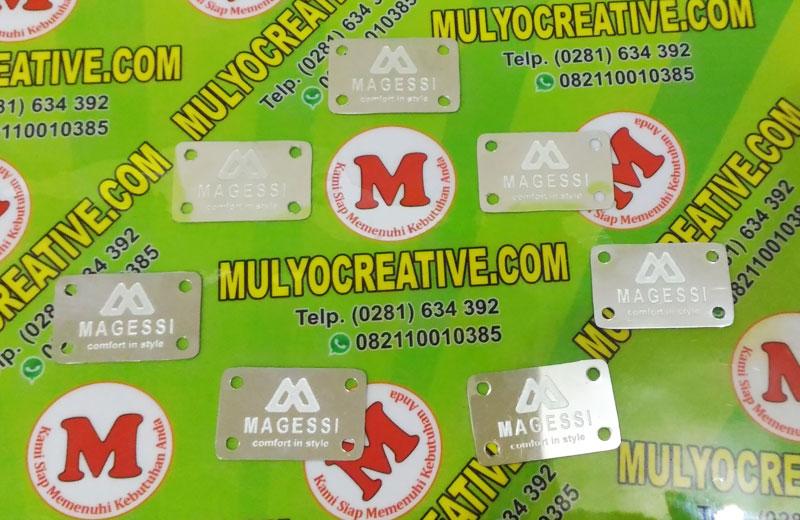 Label Brand Tas Magessi bahan: logam stainless