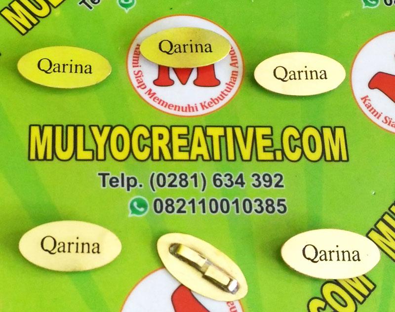 Label Brand Tas Qarina bahan: logam kuningan warna: hitam